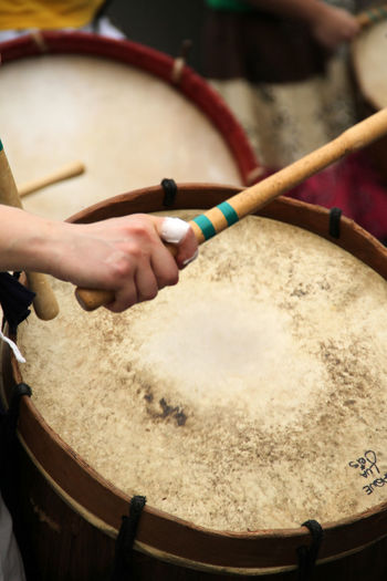 Cropped Image Of Hand Playing Drum