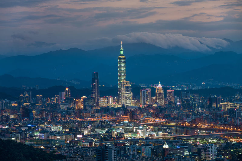 The Taiwanese capital at dusk as seen from the mountains. 101 101 Taipei ASIA Asian  Taipei,Taiwan Taiwan Building Building Exterior Built Structure Cityscape Cloud - Sky Financial District  Illuminated Modern Mountain Mountain Range Nature Office Building Exterior Outdoors Skyscraper Taipei Tall - High Tower Travel Destinations Urban Skyline First Eyeem Photo
