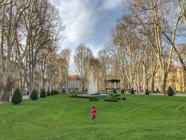 Zagreb park Croatia Zagreb Children Childhood Plant Grass Real People Tree Nature Sky One Person Women Child Lifestyles Day Green Color Cloud - Sky Field Land Growth Leisure Activity Outdoors Childhood