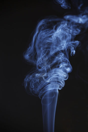aroma smoke on the black background Smoke - Physical Structure Black Background Studio Shot Indoors  Copy Space Close-up Motion No People Abstract Nature Pattern Swirl Moving Up Incense Burning Cigarette  Changing Form Illuminated Still Life Burnt