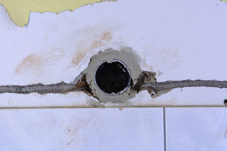 Laying of electric cables on a construction site. Electrician  Electrician; Cable; Power Line  Cable; Close-up Day Domestic Kitchen Domestic Room Drain Electric Cable No People Outdoors Sink Water White Color