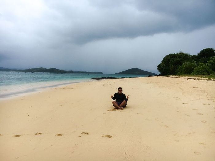 Dark, cloudy sky and the beach Rash Vest Rashguard Rash Guard Caramoan Survivor Caramoan Caramoan Island Caramoan Island, Camarines Sur Cloud - Sky Sky Land Beach Water Sea Sand Beauty In Nature Scenics - Nature Tranquility Sitting