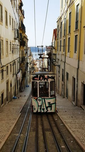Railroad Track Transportation Mode Of Transport Building Exterior Outdoors Built Structure Architecture Cable Rail Transportation Sky Public Transportation City No People Day Lisbon - Portugal Lisbon Tramway Lisbon Tram Travel Destinations Travel Portugal The Traveler - 2018 EyeEm Awards My Best Travel Photo