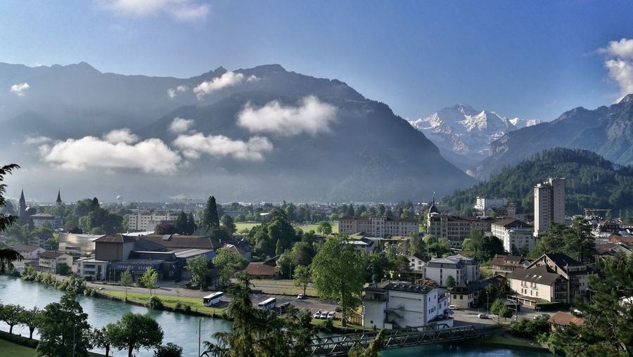 my hometown Switzerland Eye4photography  Sunlight Interlaken Berner Oberland Bernese Oberland Morning City Cityscape Mountain Modern Tree Urban Skyline Skyscraper Business Finance And Industry Business Downtown District Foggy Mountain Range Snowcapped Mountain TOWNSCAPE Fog