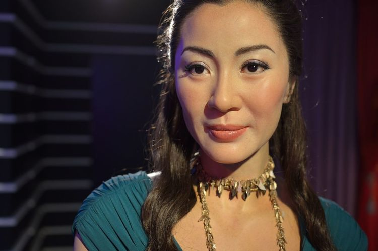 Michelle Yeoh Confidence  Contemplation Front View Happiness Head And Shoulders Headshot Human Face Lifestyles Long Hair Looking At Camera Madame Tussauds Person Portrait Real People Serious Smiling Wax Dolls Wax Museum Young Adult Young Women