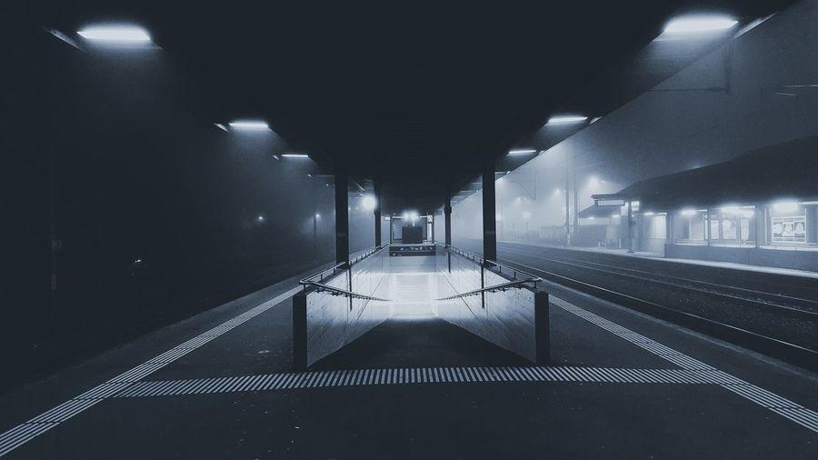 Illuminated railroad station at night