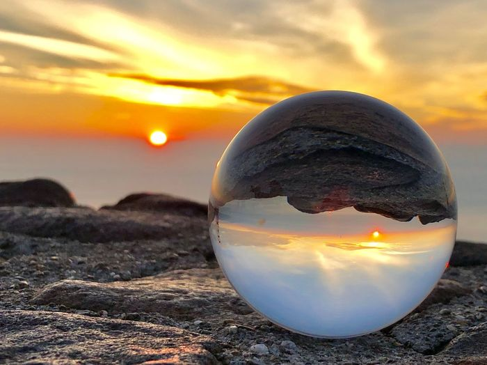 Lensball Sunset Sky Sphere Nature Land Beauty In Nature Beach Close-up Scenics - Nature Water Focus On Foreground Cloud - Sky Sun Orange Color Reflection Sea No People Tranquility Crystal Ball Outdoors