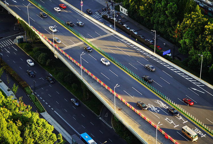 The sunset light shines on an viaduct, which is the time to get off work. Aerial View Architecture Car City Day High Angle View Motion No People Outdoors Road Speed Street Traffic Transportation Tree
