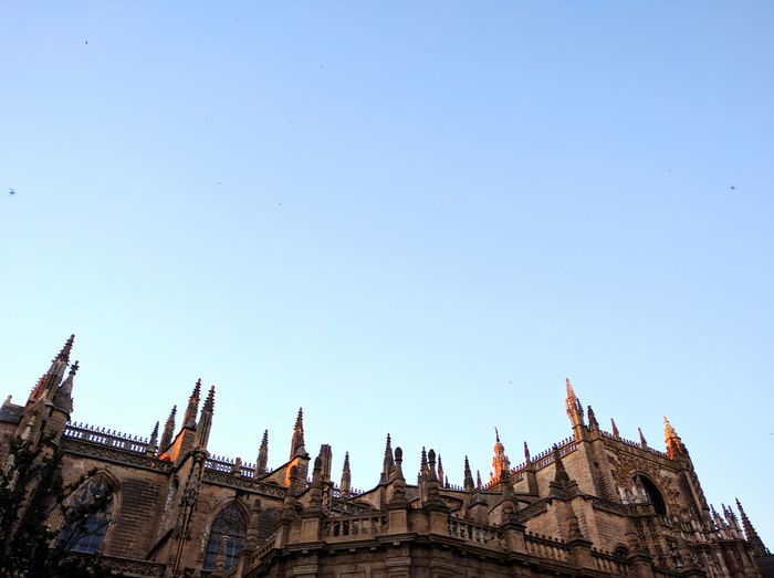 Low Angle View Of Seville Cathedral Against Clear Sky In City