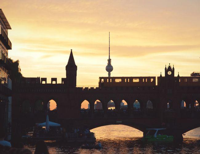 Oberbaum Bridge Over Spree River Against Fernsehturm During Sunset