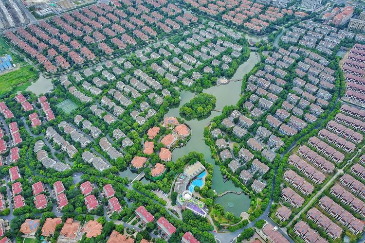 Aerial view of houses in city during rainy season