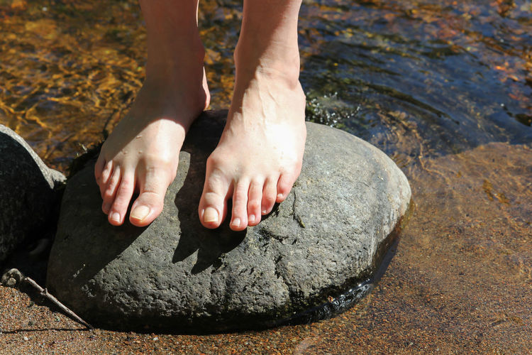 Summer Paddling Ripples Woman barefoot Body Part Day High Angle View Human Body Part Human Foot Human Leg Leisure Activity Lifestyles Light And Shadow Low Section Nature One Person Outdoors Paddling Real People River Rock Rock - Object Solid Stream Summer Water
