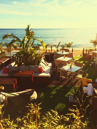 High angle view of table and chairs at beach restaurant