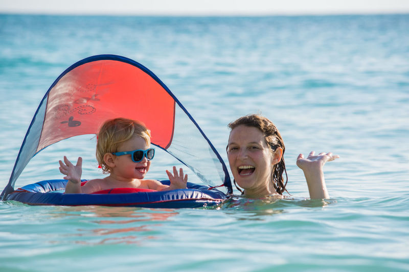 Mother with son enjoying in sea
