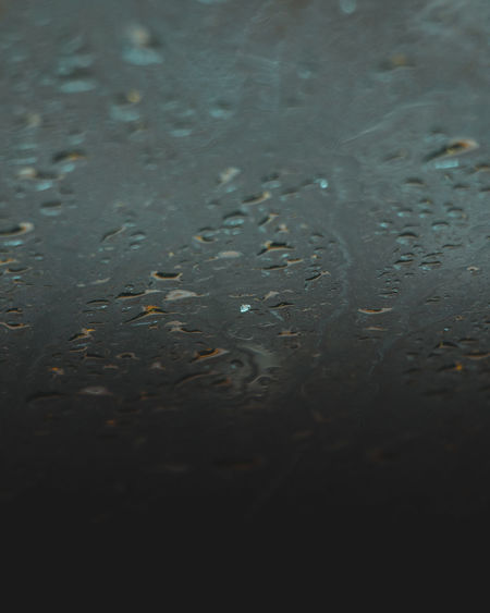 Full frame shot of raindrops on water