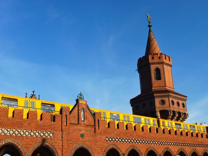 Low Angle View Of Train On Oberbaumbruecke Against Blue Sky