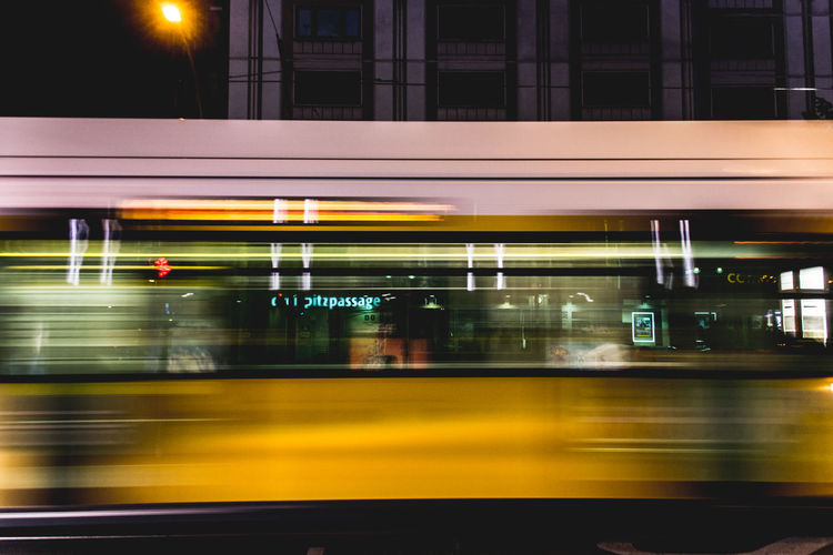 Blurred Motion Of Tram In City At Night