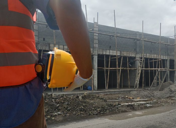 Rear view of man working at construction site