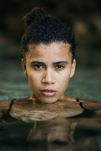 Close-Up Portrait Of Young Woman Swimming In Sea