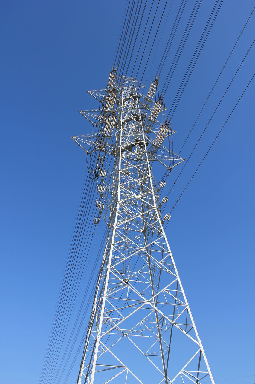 sky, low angle view, clear sky, connection, cable, electricity, blue, technology, fuel and power generation, electricity pylon, power supply, nature, power line, no people, tall - high, day, metal, built structure, outdoors, tower, complexity, electrical equipment, directly below, global communications