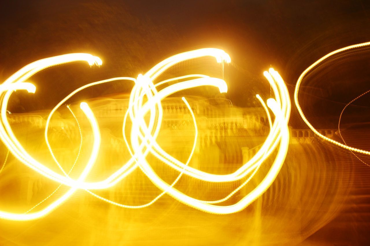 illuminated, night, long exposure, motion, glowing, light trail, blurred motion, pattern, light - natural phenomenon, speed, orange color, no people, creativity, abstract, yellow, nature, light painting, outdoors, shape, water