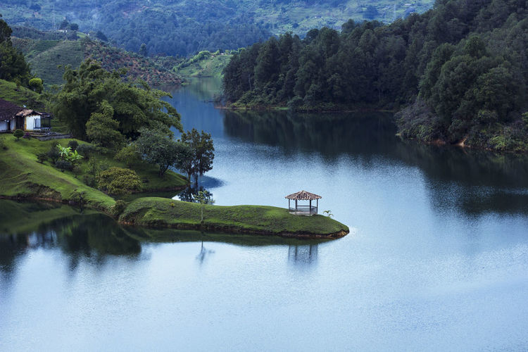 Beautiful lakeview close to El Penol de Guatape. Colombia Pagoda Serenity Beauty In Nature Day Green Color Growth Guatape Idyllic Lake Lake View Nature No People Non-urban Scene Outdoors Paradise Pavilion Plant Reflection Scenics - Nature Tranquil Scene Tranquility Tree Water Waterfront