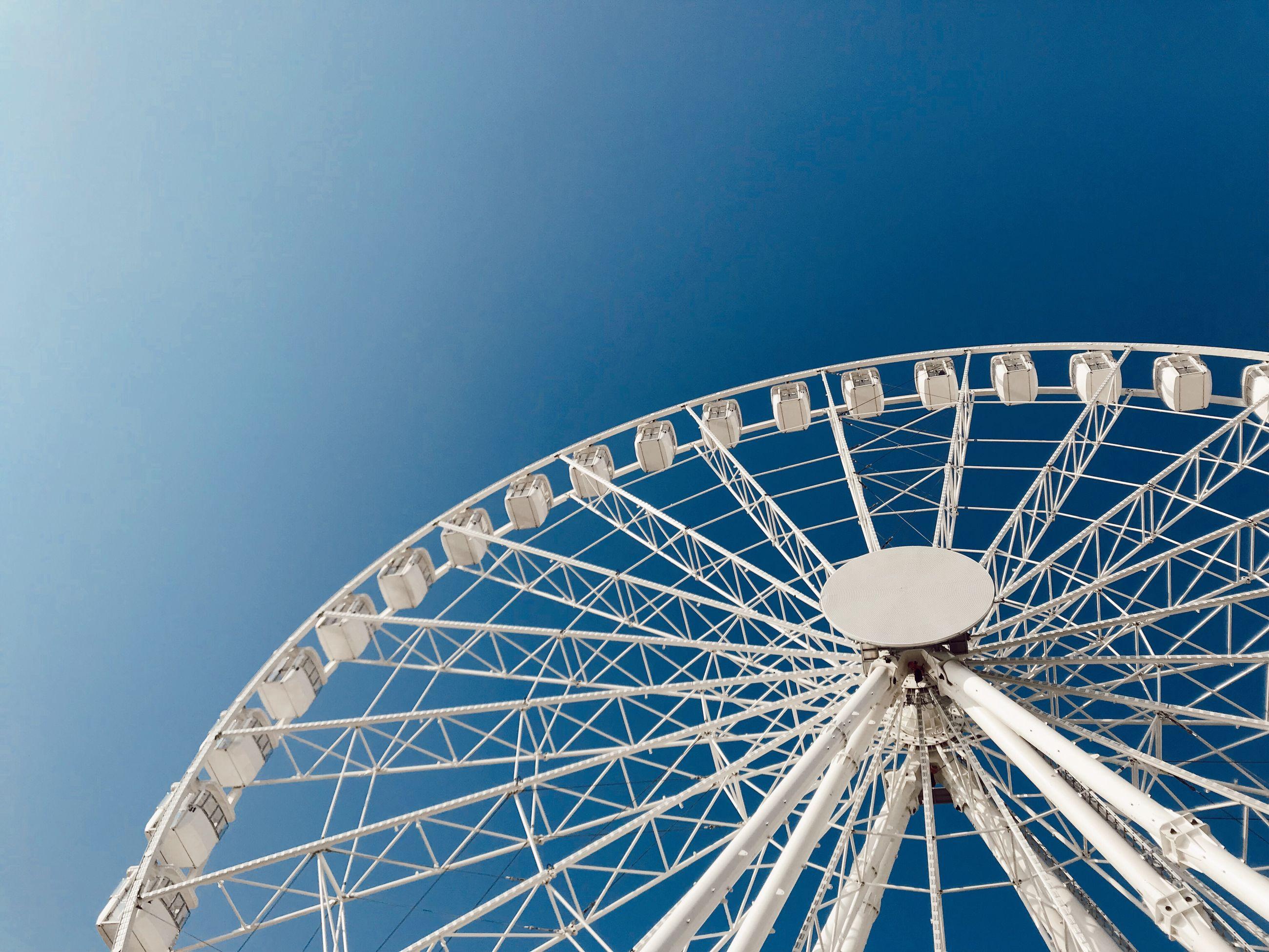 amusement park, amusement park ride, sky, ferris wheel, blue, arts culture and entertainment, clear sky, low angle view, nature, no people, large, fairground, outdoors, leisure activity, copy space, built structure, day, shape, circle, metal