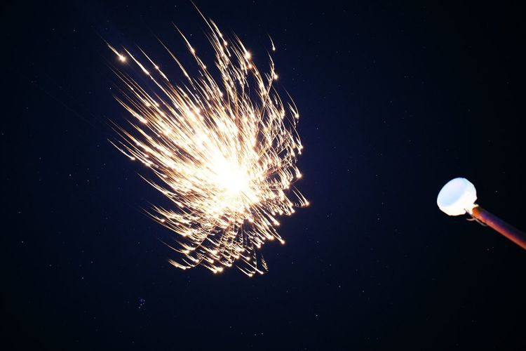 Night Exploding Firework - Man Made Object Firework Display Low Angle View Long Exposure Motion Arts Culture And Entertainment Celebration No People Outdoors Illuminated Sky Astronomy Diwali Crackers🔥💥 Crackers In Sky