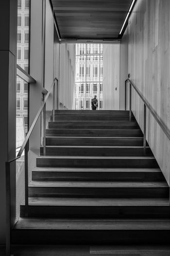 Rear view of people walking up stairs