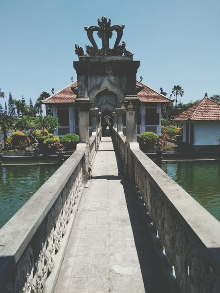 Architecture Travel Destinations Sky Built Structure History Tourism Cloud - Sky Travel Water Outdoors Day No People Cityscape Building Exterior Tree Royalty Politics And Government City Indonesia_photography Palace Garden Landscape Bali, Indonesia INDONESIA Taman Ujung Water Palace