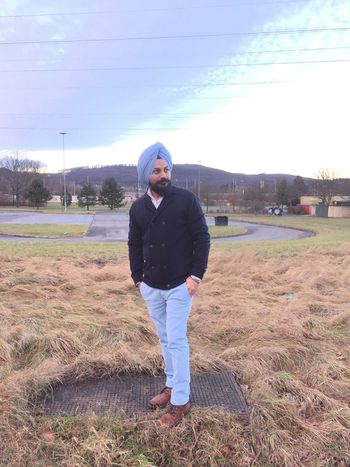 Beard Confidence  Day Front View Full Length Grass Headwear Leisure Activity Lifestyles Looking At Camera Men Nature One Man Only One Person Only Men Outdoors Portrait Real People Sikh Sky Standing Turban Young Adult
