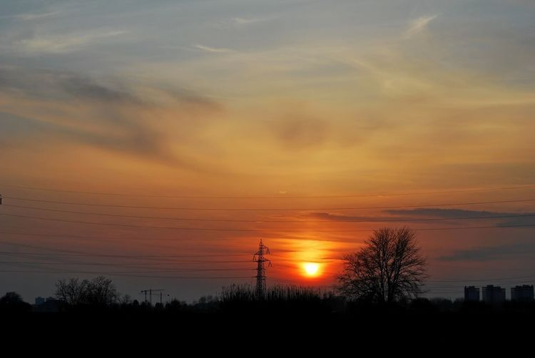 Bare Tree Beauty In Nature Chiaravalle, Milano Cloud - Sky Electricity Pylon Landscape Nature No People Orange Color Outdoors Scenics Silhouette Sky Sunset Tranquil Scene Tranquility Tree