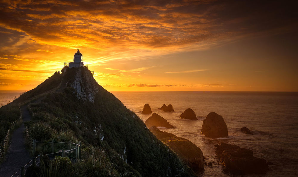 Nugget Point New Zealand Lighthouse Lighthouses Morning Morning Light New Zealand Scenery Silhouette Architecture Beauty In Nature Day First Light Horizon Over Water Lighthousephotography Nature New Zealand No People Ocean Outdoors Scenics Sea Sky Sunrise Sunset Tranquil Scene Tranquility Water