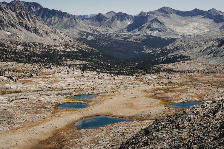 High Sierra Sierra Nevada Mountains California Pacific Crest Trail John Muir Trail Hiking Mountain Range Mountains Lakes  Thru Hiking Mountain Scenics - Nature Beauty In Nature Water Tranquil Scene Landscape Tranquility Non-urban Scene Environment No People Nature Lake Day Physical Geography Outdoors Geology High Angle View Land Idyllic Arid Climate