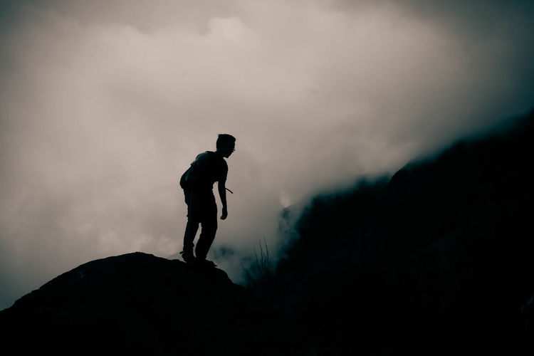 Silhouette Of Man On Mountain
