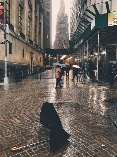 The Street Photographer - 2017 EyeEm Awards Architecture Built Structure Building Exterior Water Wet Real People City Street Men Day Full Length Outdoors Travel Destinations Lifestyles Adult People Umbrella Iphoneonly