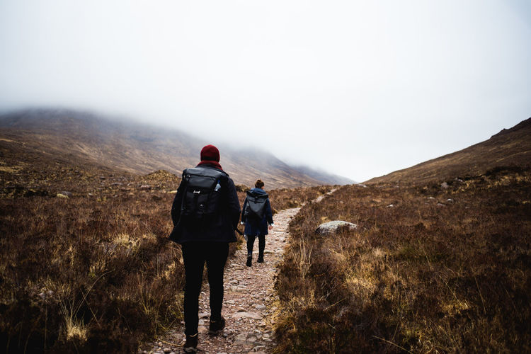 Mountain Sky Landscape Backpack Adventure Activity Outdoors Real People Hiking Scotland Foggy Misty Path Nature Beauty In Nature Scenics - Nature