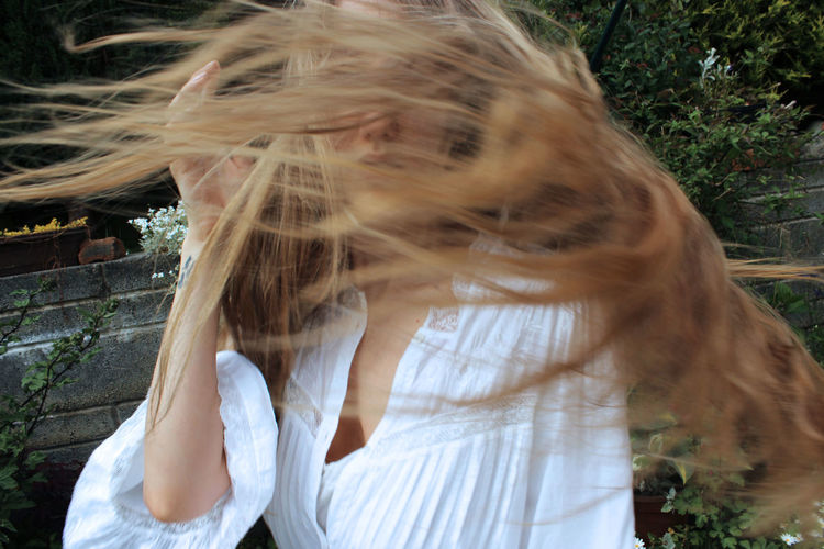 Portrait Of Woman Tossing Hair