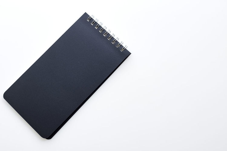 School Notebook Business Workplace Office Object NotePad White Background Paper Blank Note Isolated Spiral Book Pad Page Top View Empty Space Desk Sheet Design Template Document Diary Copy Table Open Pen Education Message Mockup Pencil Write Clean Binder Concept Textbook White Background Copy Space Studio Shot Still Life Publication Note Pad Indoors  Cut Out No People High Angle View Close-up Black Color Single Object Spiral Notebook Hardcover Book