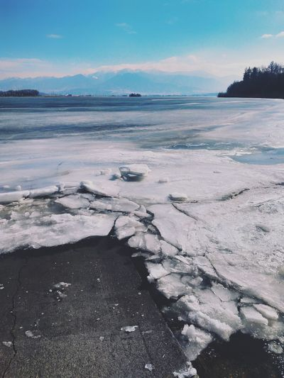 Melting Ice Frozen River Riverbank Mountains Spring Has Arrived Winter Landscape Cold Temperature Blue Sky Cracked Ice