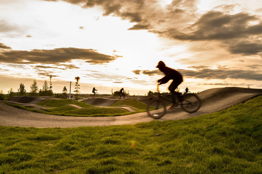 Extreme Sports - Sunset Cycle Track Excercising Bicycle Bicycle Track Cycle Track Cycling Day Extreme Sports Full Length Grass Leisure Activity Men Nature One Person Outdoors People Real People Riding Sky Sport Sports Stunt Sunset Track Urban