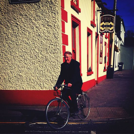 Ireland Athy Ireland Mode Of Transport Bicycle Transportation Built Structure Building Exterior One Person Full Length Land Vehicle Outdoors Architecture Cycling Real People Day City One Man Only Lifestyles Men Only Men Young Adult Adults Only