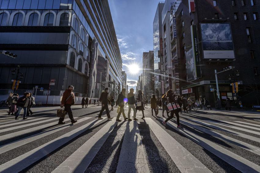 Adult Adults Only Architecture Building Exterior Built Structure City City Life Day Ginza Only Men Outdoors People Shadows Sky Street Photography Walking
