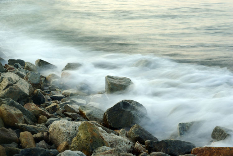Scenic view of sea waves rocks