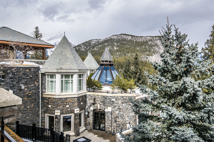 Banff  Banff National Park  Banff Springs Hotel Mountain View Architecture Belief Building Building Exterior Built Structure Cloud - Sky Cold Temperature Day House Mountain Nature No People Outdoors Place Of Worship Plant Religion Residential District Sky Spirituality Tree Winter