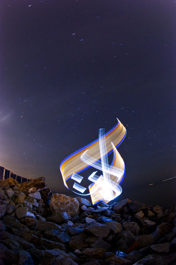 Abstract light graffiti or light painting using Arabic Calligraphy (using led lights and slow shutter photography) Abstract Arabic Calligraphy Beach Bulgaria Calligraffiti Calligraffity Calligraphy Galaxy Landscape Led Lights  Light Graffiti Light Painting Long Exposure Motion Light Night Outdoors Slow Shutter South Star Space And Astronomy Star - Space