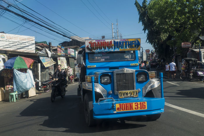 Blue Cainta City Life Clear Sky Day Here Belongs To Me Incidental People Jeepney Land Vehicle Mode Of Transport Philippines Power Line  Public Transportation Rizal Road Street Transportation Travel