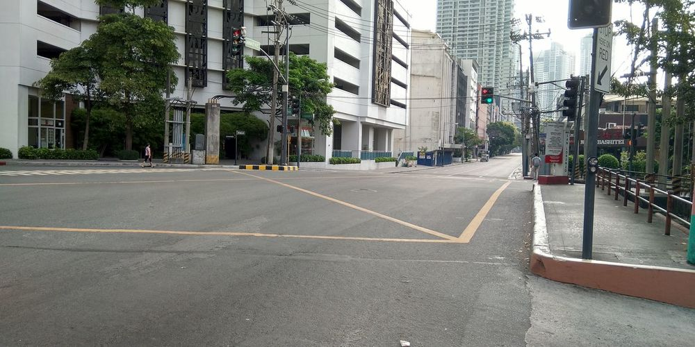 Surface level of street amidst buildings in city