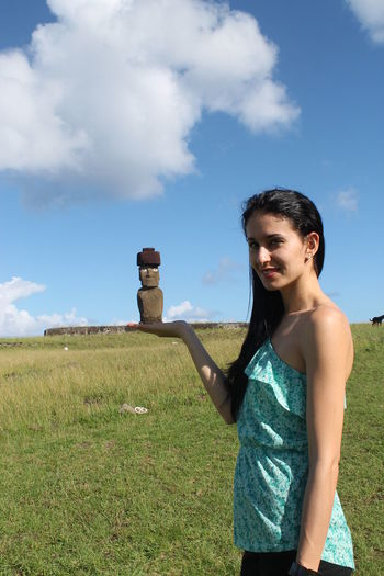 Young woman standing and pretending to hold statue of Moai in the hand Chile Easter Island Isla De Pascua Moai Cloud - Sky Day Field Grass Leisure Activity Lifestyles Moai Statues Nature One Person Outdoors People Real People Sky South America Standing Young Adult Young Women Eyeemtravel  EyeEmPremiumShot Premium Collection Eyeemtraveler✌