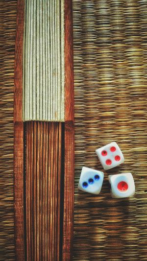 Directly above shot of dice on tatami mat